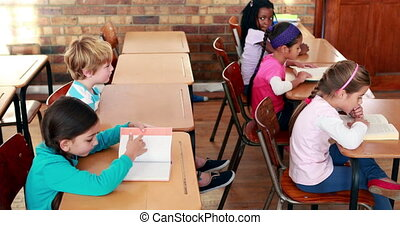 Cute schoolchildren reading