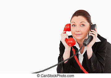 Cute secretary answering two phone calls at the same time...