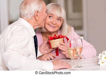 Cute senior couple celebrating their love
