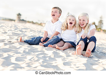 Adorable Sibling Children Portrait at the Beach.