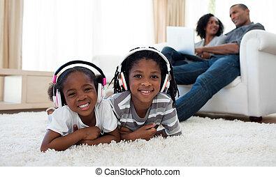 Cute siblings listening music in the living room