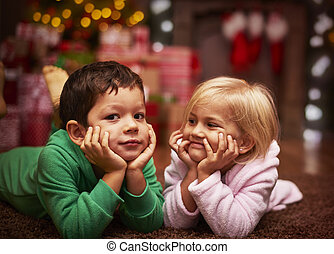 Cute siblings spenting their christmas time together