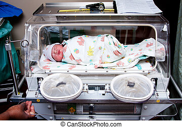 Cute sick baby in incubator - Cute sick newborn premature...
