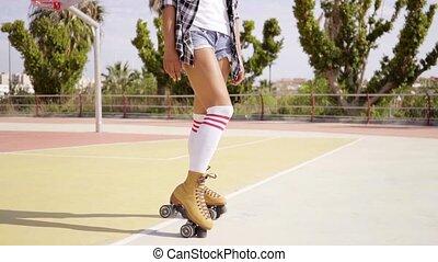 Cute single woman on roller skates - Cute single woman in...