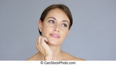 Cute single young adult woman with closed eyes - Front view...