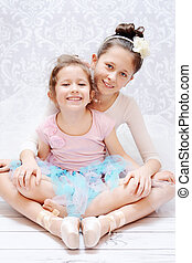 Cute young sisters during ballet rehearsal