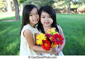 Cute Sisters with Flowers