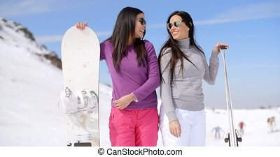 Cute sisters with snowboards