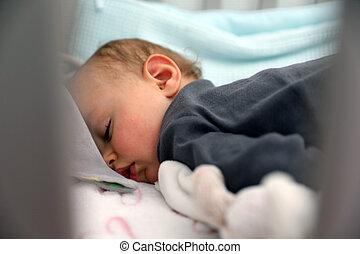 Cute Sleeping Baby Boy In Crib