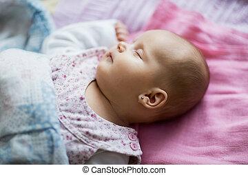 Cute sleeping baby lying on bed