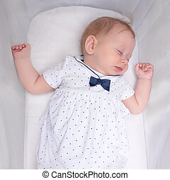 Cute sleeping girl. Baby sleep concept. Newborn baby in her crib.