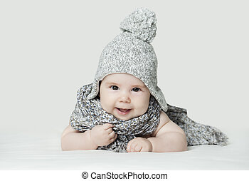 Cute small baby in knitted hat, portrait. Happy little child (3 months old)