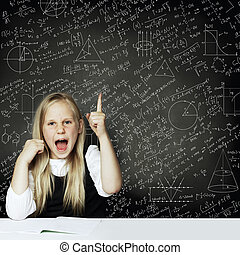 Cute smart child student girl have idea. blackboard background with science formulas. Learning science concept.