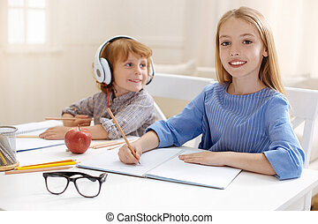 Cute smart siblings studying together