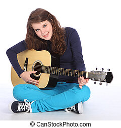 Cute smile by teenager girl on acoustic guitar