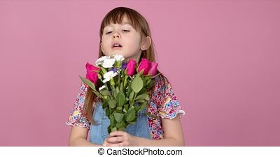 Cute smiling adorable child girl holding bouquet of spring ...