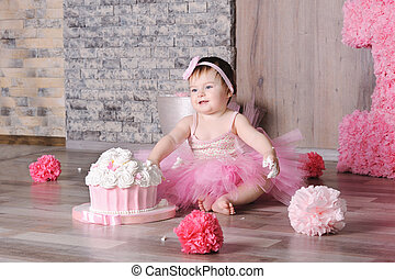 Cute smiling baby girl in pink dress
