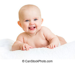Cute smiling baby girl lying on towel isolated on white