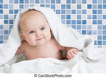 Cute smiling baby kid after bathing in bathroom