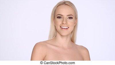 Cute Smiling Blond Girl Posing in Studio