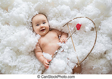 Cute smiling caucasian baby cupid on white clouds background with bow and heart arrow. Happy Valentines day concept.