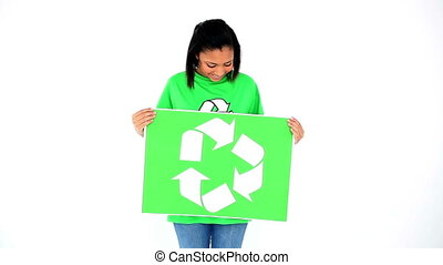 Cute smiling environmental activist presenting a poster with...