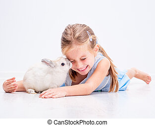 cute smiling girl with a white rabbit - cute smiling girl in...