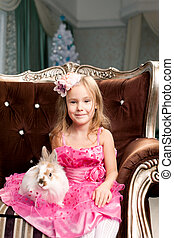 Cute smiling girl with bunny