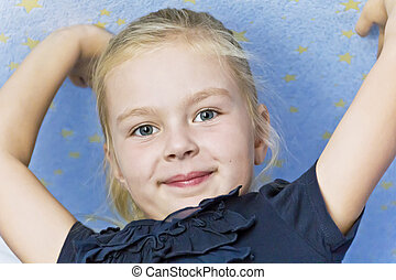 Cute smiling girl with upwards hands