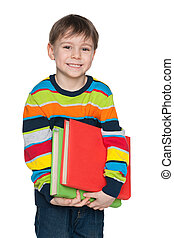 Cute smiling little boy with books