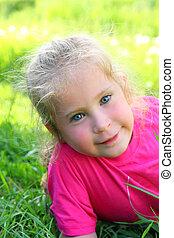 smiling little girl outdoor portrait