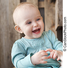 Cute smiling ten month old baby