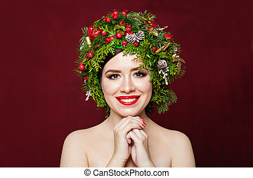 Cute smiling woman in Christmas decor on red background
