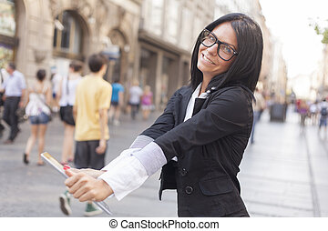 Cute smilling businesswoman with tablet computer