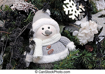 cute snowman in Christmas tree decoration