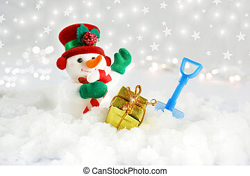 Cute snowman in snow with shovel and gift