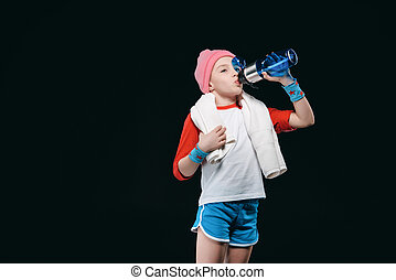 Cute sporty girl drinking water from bottle, activities for children concept