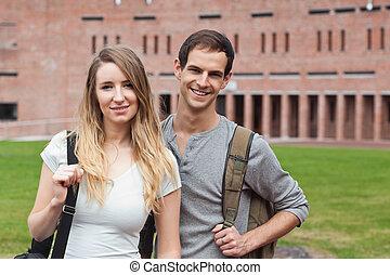 Cute student couple posing