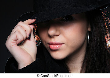 c27e2786bbf Beautiful steampunk lady in a victorian style wears a bowler hat ...