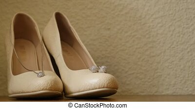 Cute stylish beige high heels on the background room,...