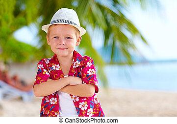 cute stylish boy on the beach