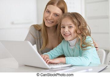 Cute teacher and little girl
