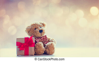 cute teddy bear and beautiful gift on the fairy lights bokeh...