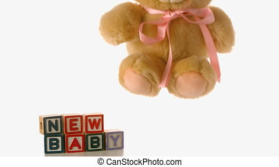 Cute teddy bear falling besides bab - Cute teddy bear...