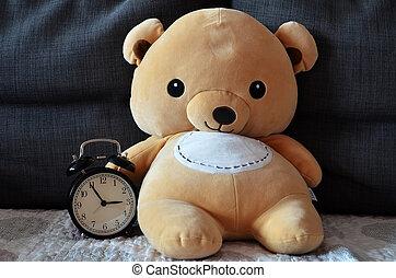 Cute teddy bear hold alarm clock