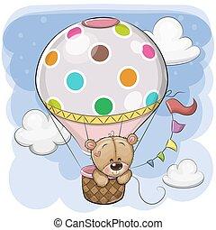 Cute Teddy Bear is flying on a hot air balloon