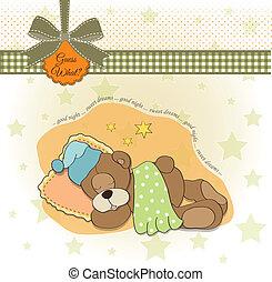 cute Teddy Bear sleeps on pillow