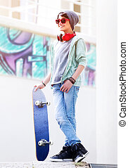 Cute teen boy with skateboard