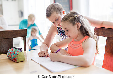 cute teen girl doing homework at home
