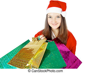 cute teen girl dressed as Santa with presents